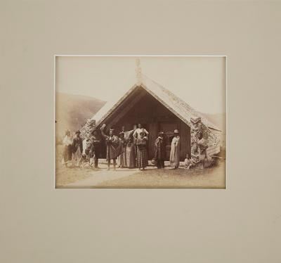Photograph [Maori people standing outside a meeting house]