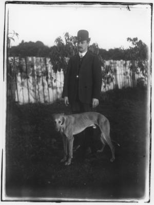Glass plate negative – man and greyhound