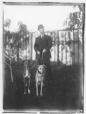 Glass plate negative – man and two greyhounds
