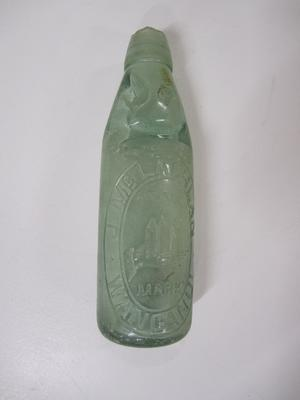 Glass cordial bottle repurposed as 'money box'