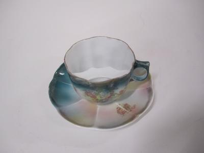 Cup, moustache and saucer