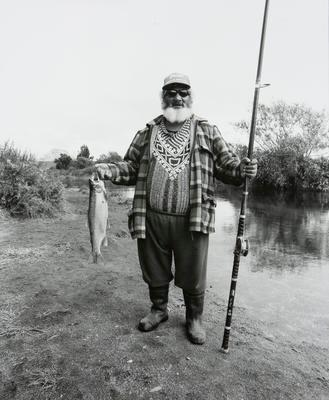 Tai Thompson with trout at the mouth of the Waiahanui Stream, Taupo