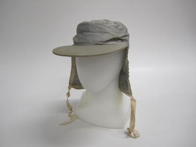 Peaked cap with neck flaps