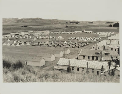 Photograph: General view of huts and tents