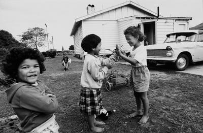 The Nicholls Children Play Outside Their Home After School