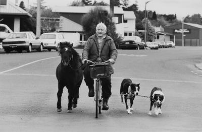 John Tarrant Tethers His Pony To His Bicycle And Leads Her To A Fresh Grazing Spot In The Town