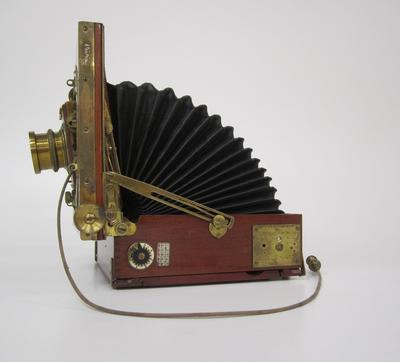 Camera, folding stand