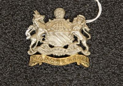 Hat badge – Manchester Regiment