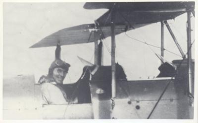 "Photograph – Tom Mullan in aircraft ""Kia Ora"""