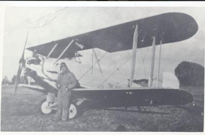 "Photograph – Mr Blackmore and aircraft ""Bluebird"""