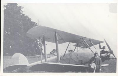 """Photograph – Stan and Warwick Blackmore in front of aircraft """"Bluebird"""""""