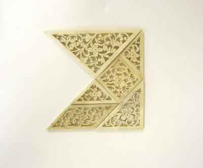 Ivory tangram puzzle
