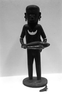 Male figurine with fish